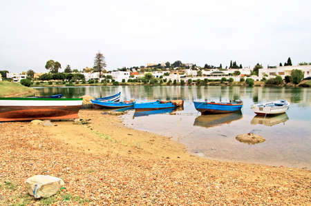 Boats near village in Carthage, Tunisia photo
