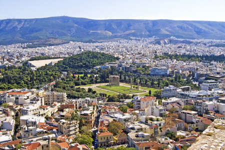 View from Acropolis on columns of Zeus Temple in Athens, Greece photo