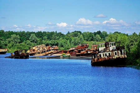 Old rusty ships in the river near Chernobyl Stock Photo