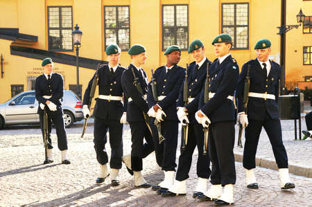 STOCKHOLM, SWEDEN - JULY 1: Soldiers are waiting changing of the Guard ceremony on July 15, 2010 in Stockholm, Sweden. This daily ceremony takes place at noon and attracts hundreds of tourists