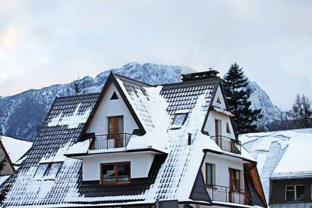 Mountain houses covered with fresh snow in Chocholowska valley - Tatra Mountains photo