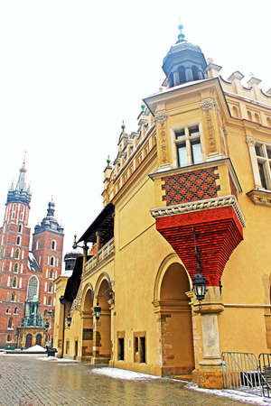 Sukiennici and St. Marys Church in Krakow, Poland photo