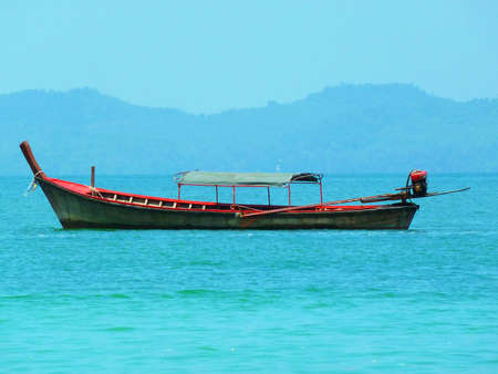 longtail: Traditional longtail boats in Phuket in the Andaman Sea, Thailand  Stock Photo