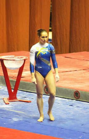 KYIV, UKRAINE - MARCH 31: Alina Fomenko (Ukraine) prepares to do exercises at sporting gymnastics