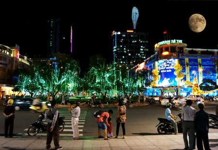 Ho Chi Minh City, Vietnam - January, 18: People are walking at night on January, 18 in Ho Chi Minh City, Vietnam