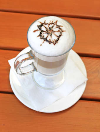 Latte macchiato with cocoa powder in the form of flower Stock Photo - 17067718