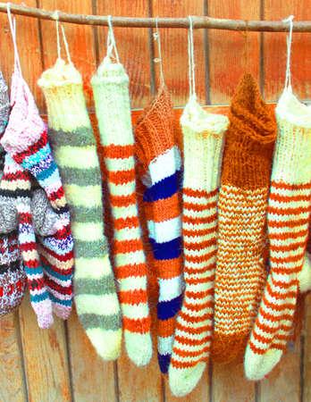 Handmade wool socks hanging on a clothesline