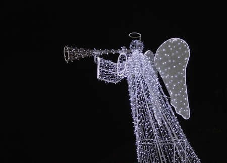 Angel playing on trumpet, xmas illumination in Krakow, Poland