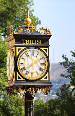 Old street clock in Tbilisi, Georgia Stock Photo