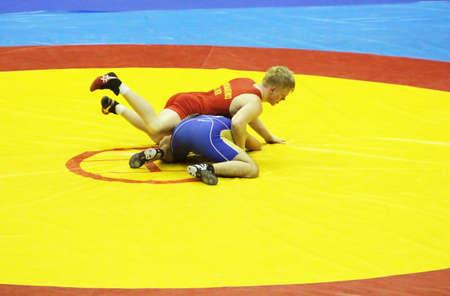 catch wrestling: KYIV, UKRAINE - FEBRUARY 16: Rustambek Mashadov (Russia)  fight against Ponomarenko (Ukraine) during 19 International Tournament in wrestling February 16, 2013 in Kyiv, Ukraine