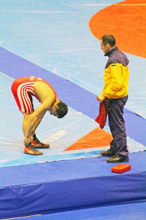 catch wrestling: KYIV, UKRAINE - FEBRUARY 16: Arsen Yedigarov (Ukraine) rests with his coach during 19 International Tournament in wrestling February 16, 2013 in Kyiv, Ukraine