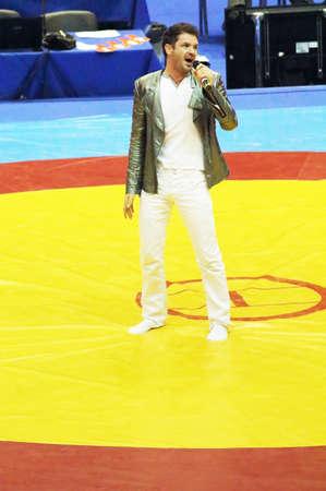 catch wrestling: KYIV, UKRAINE - FEBRUARY 16: Winner of X-factor Ukraine Victor Romanchenko on the opening ceremony of 19 International Tournament in wrestling February 16, 2013 in Kyiv, Ukraine Editorial