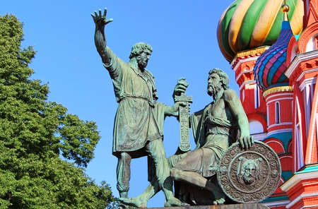 Statue of Kuzma Minin and Dmitry Pozharsky in front of St. Basil Cathedral. The cathedral was built between 1555 and 1561 by the architects Barma and Postnik Yakoviev. Stock Photo - 20316193