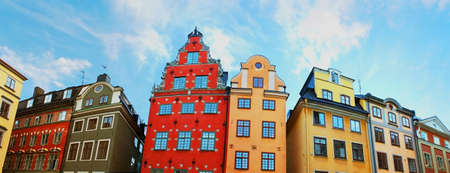 Red and Yellow iconic buildings on Stortorget, a small public square in Gamla Stan, the old town in central Stockholm, Sweden photo