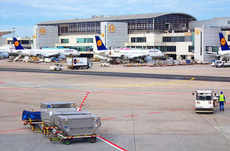 airport runway: Aircrafts at the gate in Terminal 1 in Frankfurt, Germany  Terminal 1 was completed in 1972 and houses Lufthansa and other Star Alliance partners Editorial