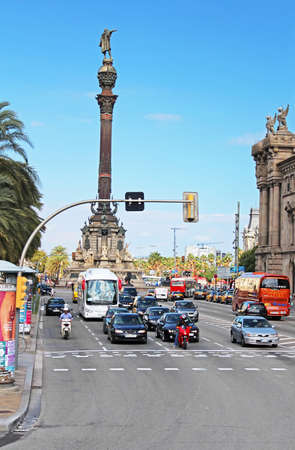 Traffic near Columbus monument in Barcelona, Spain  Columbus Monument is 60 m  It is located at finish La Rambla and built in 1888 Editorial