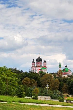 Majestic church towers above the large green garde photo