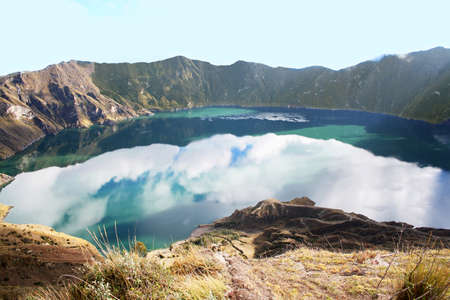 catastrophic: Quilotoa is a water-filled caldera that was formed by the collapse of the volcano following a catastrophic eruption about 800 years ago  Quilotoa is a tourist site of growing popularity  Stock Photo