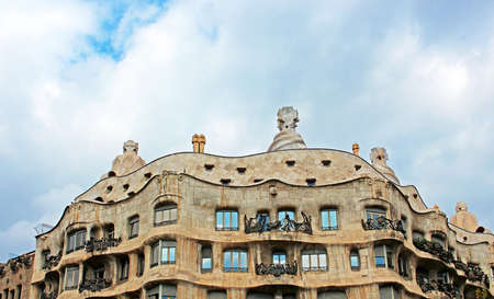 famous building: BARCELONA, SPAIN - OCTOBER 08  Casa Mila or La Pedrera on October 08, 2013 in Barcelona, Spain  This famous building was designed by Antoni Gaudi and is one of the most visited of the city