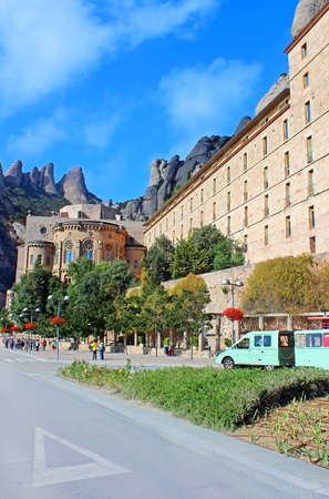 People are going to Montserrat Benedictine monastery, religious center of Catalonia, Montserrat, Spain  The monastery is 48 kilometres  30 mi  west of Barcelona, and can be reached by road, train or cable car Editorial