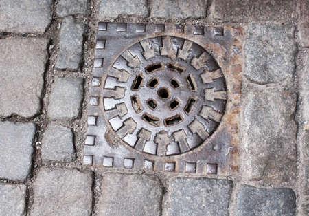 ink well: Sewer manhole in Stockholm, Sweden