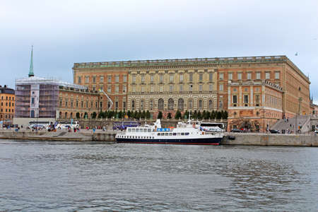 Unidentified tourists visit Royal Palace in Stockholm, Sweden  The palace has 1430 rooms, 660 with windows and is one of the largest royal palaces in the world still in use for its original purpose Editorial