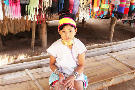 Unidentified Karen tribal girl near Mae Hong Son, Thailand, Chiang rai, Karen Long Neck hill tribe village  The Karen people wear brass rings around their neck from five years old