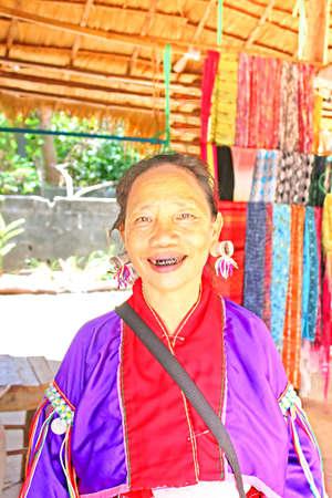 Unidentified Padaung  Karen  tribe woman  in traditional costume near Mae Hong Son, Thailand, Chiang rai, Karen Long Neck hill tribe village