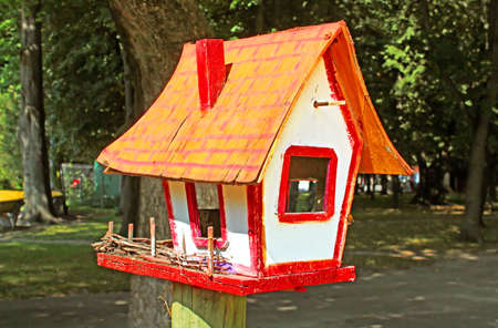 pigeon holes: Birdhouse at park
