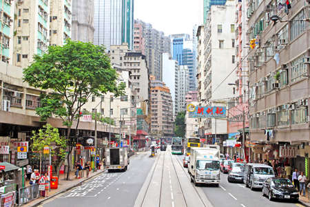 Unidentified people are walking on the street in Hong Kong  With a 7 million people, Hong Kong is one of the most densely populated areas in the world