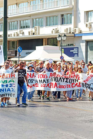 austerity: Greek are protesting against the new austerity measures and the job losses in Athens,Greece