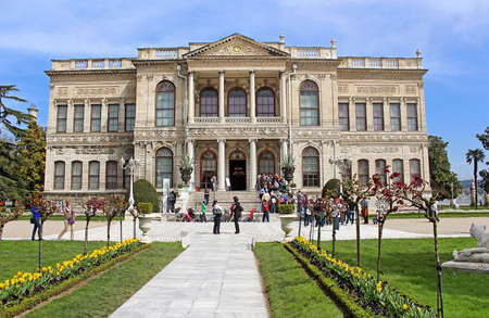 ottoman empire: Unidentified people at Dolmabahce Palace in Istanbul, Turkey. Dolmabahce Palace was ordered by the Ottoman Empire