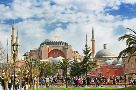 View of Hagia Sophia and the area with tourists, citizens and street sellers Editorial