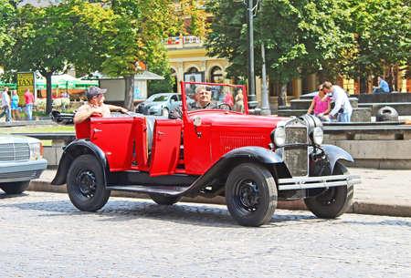 tage: Retro car on the street in Lviv on the frame of classic car festival \\\Leopolis Grand Prix 2014\\\ in Lviv, Ukraine