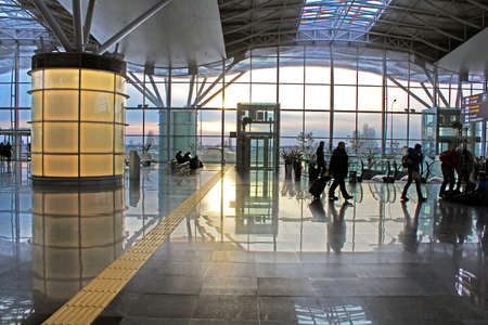 regular people: Silhouettes of inidentified people at International Airport Boryspil in Kyiv, Ukraine in the morning. Terminal F handling regular flights with an initial capacity of 900 passengershour