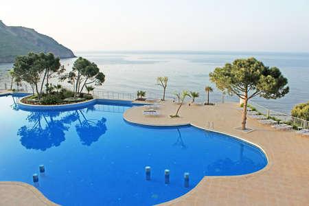 Swimming pool area near Mediterranean Sea in the morning, Turkey