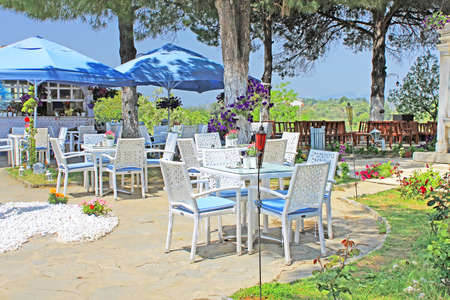 bluey: Cafe on the open air with white furniture