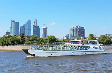 moskva river: View of Moscow river, pleasure boat and Moscow International Business Center (Moscow City), Russia