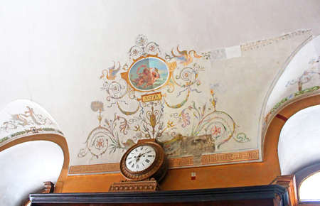 Ceiling and clock in pharmacy-museum in Lviv, Ukraine. The Pharmacy Museum in Lviv was opened in 1966 in the building of an old drugstore at the corner of the Market Square Editorial