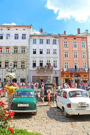 tage: Retro cars on Market square in Lviv on the frame of classic car festival \Leopolis Grand Prix 2014\ in Lviv, Ukraine