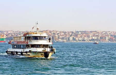Boat with passengers arrives at the European side of Istanbul from its Asian side after crossing the Bosphorus