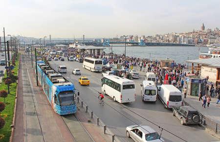 View over traffic next to Eminonu pier and Galata bridge in Istanbul, Turkey