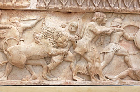 Ancient Greek sculpture representing battle, Greece photo