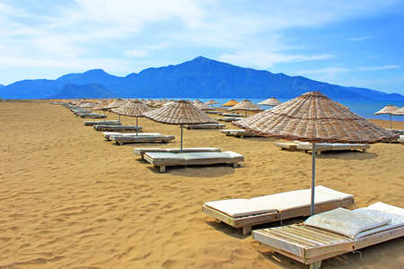 Sun loungers on a famous Iztuzu beach in Turkey Stock Photo