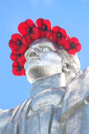 reconciliation: The monument Mother Motherland decorated with a wreath of poppies on the Day of Remembrance and Reconciliation in Kyiv, Ukraine Stock Photo