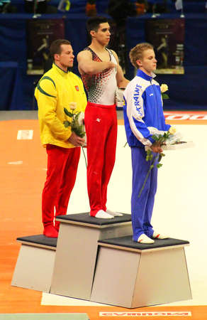 boy gymnast: Daniel Corral Mexico - in the center, Nikita Ermak Ukraine - on the right,  and Rokas Guscinas Lithuania on the left  won competition on the bars in Stella Zakharova Cup in Kyiv, Ukraine Editorial