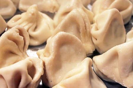 kavkaz: Traditional Georgian khinkali or dumplings, stuffed with meat - close-up