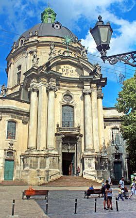 holy eucharist: Unidentified people are walking near Dominican Cathedral in the beautiful summer day in Lviv, Ukraine.  It was originally built as the Roman Catholic church of Corpus Christi, and today serves as the Greek Catholic church of the Holy Eucharist