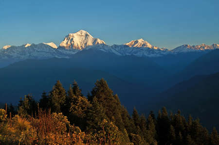 hill range: Panorama view of the majestic of himalayan mountain range during sunrise view from Poon Hill view point at Nepal Stock Photo