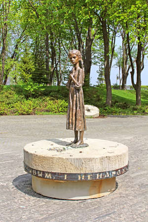 genocide: Hungry girl bronze monument and Monument to Victims of Famine devoted to genocide victims of the Ukrainian people of 1932-1933 years, Kyiv, Ukraine Editorial
